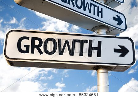 Growth direction sign on sky background