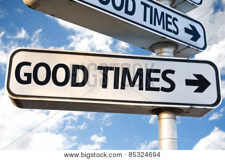 Good Times direction sign on sky background
