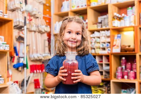 Child with color or paint pigments in store