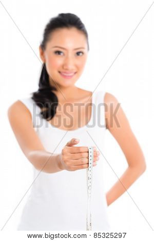 Asian woman measuring body