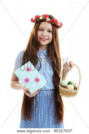 Beautiful little girl with greeting card and Easter basket, isolated on white