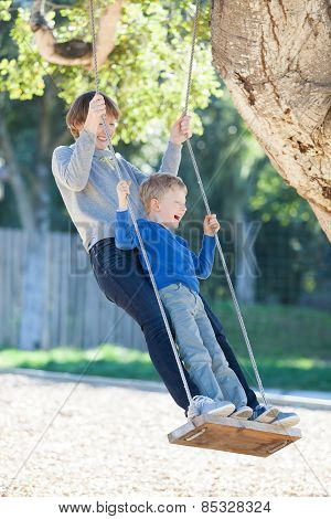 Family At Swings