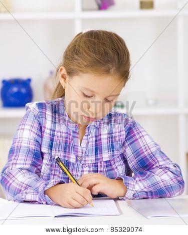 School kid writing homework