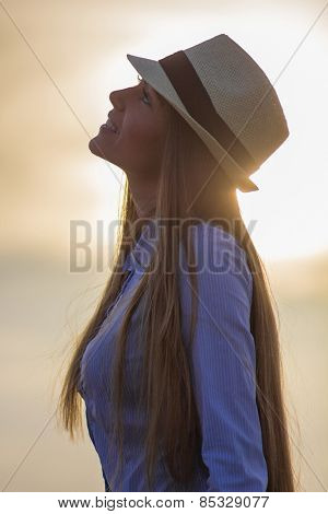 Young girl enjoying in beautiful day in nature at sunset