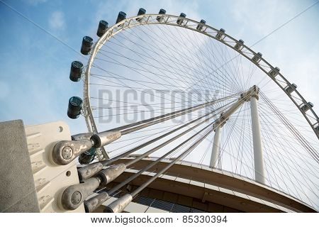 SINGAPORE - JANUARY 26, 2014: Singapore Flyer - a giant Ferris wheel, located in Singapore, built in 2005-2008. With a total height of 165 m, second tallest in the world.