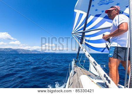 MARMARIS, TURKEY - CIRCA MAY, 2012: Unidentified sailors participate in sailing regatta Sail & Fun Trophy from Marmaris to Fethiye in the Mediterranean Sea.