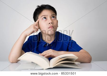 Little Asian Boy Read A Book And Think About That