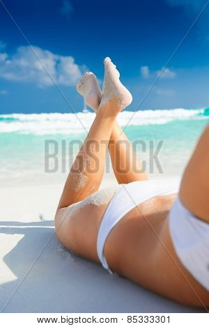 Young woman at the beach in tropical beach paradise