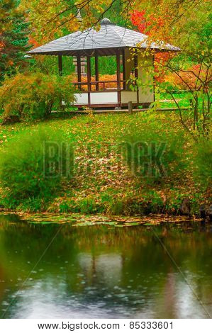 Gazebo In The Empty Autumn Park Near The Pond