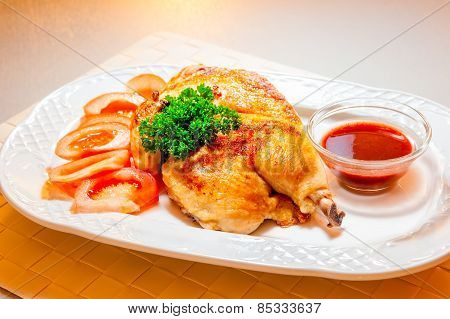 Fried Chicken Beautifully Served On A Platter With Sauce