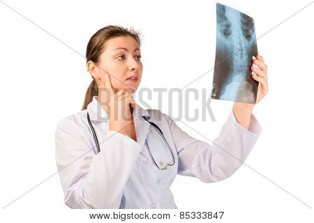 Concentrated Doctor Radiologist Examines The Picture Of The Patient