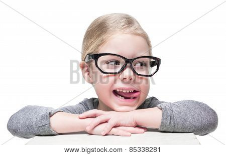 Smart Cheerful Beautiful Little Girl In Glasses Looking On Something