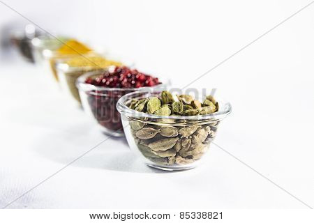 colorful spices in a glass