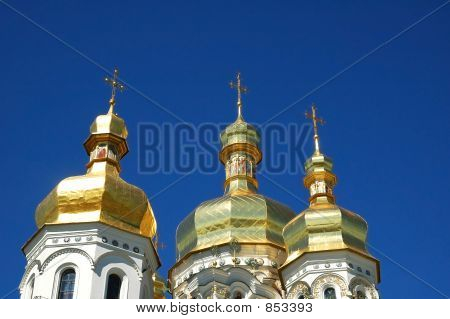 Three Towers Of A Church Across Clear Blue Sky