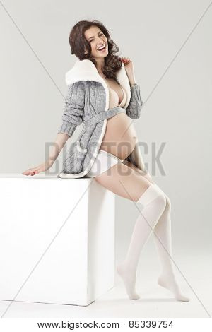 Portrait of the young pregnant woman