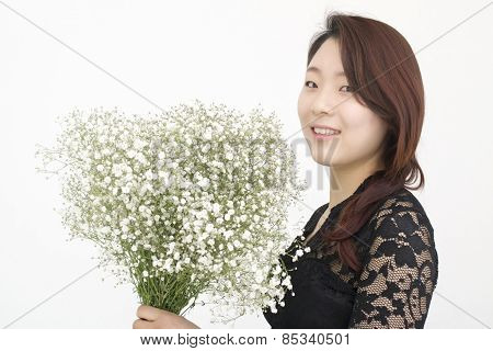 Beautiful asian woman with bouquet of gypsophila