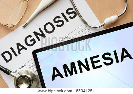 Tablet with diagnosis amnesia and stethoscope.