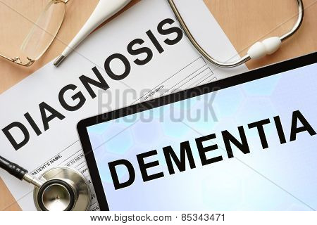 Tablet with diagnosis dementia  and stethoscope.