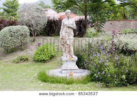 Typical Antique Figure At A Park