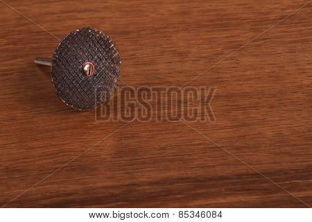 The Metal Cutting Wheel  On The Wood