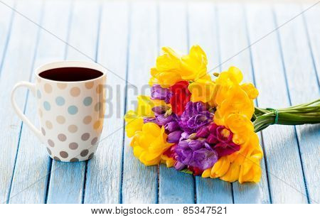 Cup Of Coffee And Bouquet Of Flowers