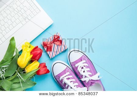 White Computer And Bouquet Of Tulips With Gumshoes