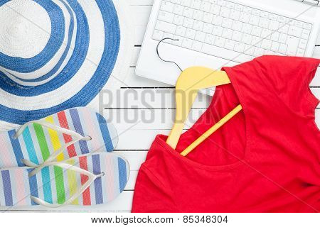 White Computer And Flip Flops Shoes With Clothes