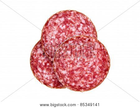 Slices of salami, isolated on a white background.