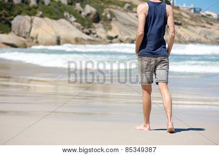 Man Walking Barefoot On White Sand Beach