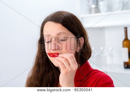 Woman Is Sniffing Sweet Pepper
