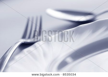Plate, Fork And Spoon In Blue