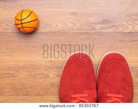 Pair of sneakers and basket ball
