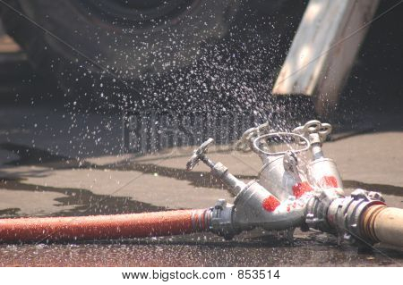 Three fire hoses with drippling water