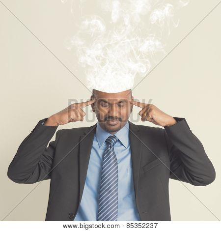 Businessman head burnout, smoke coming out from head.