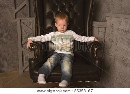Boy In Leather Chair