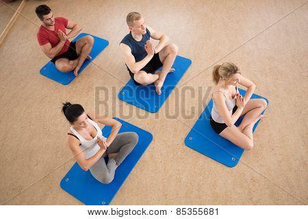 People Exercising Yoga