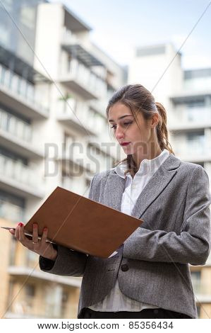 Businesswoman Looking At Some Documents