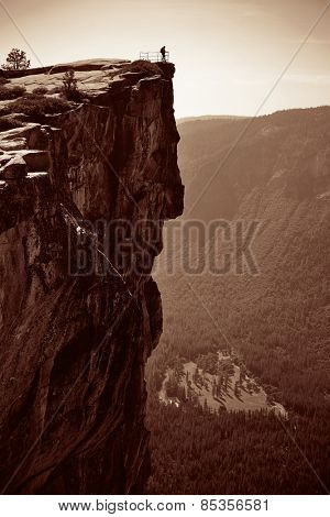 Hiker look down from Taft Point in Yosemite BW.