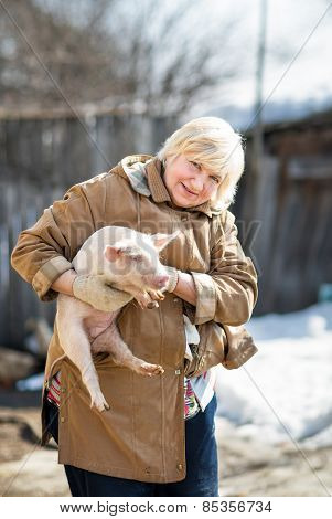 female farmer holding  pig
