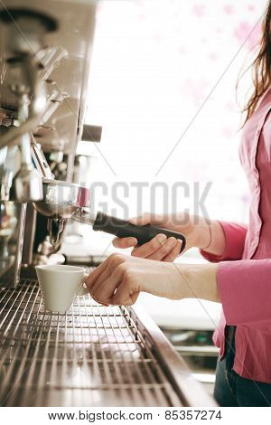 Barista Making Coffee With A Coffee Machine
