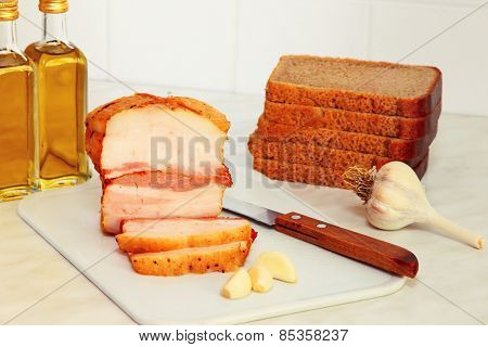 Sliced Bread,bacon And Vegetable Oil On Kitchen Table.