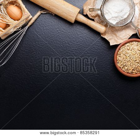 Ingredients For Baking Including Eggs And Flour, With Sieve And Whisk Flour On Empty Light Wooden Ba