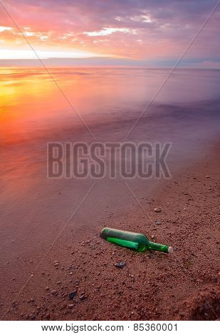 Bottle With Message On Sea Coas