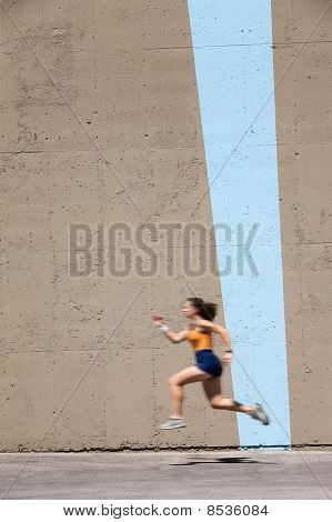 Muscular Woman Sprints To Win