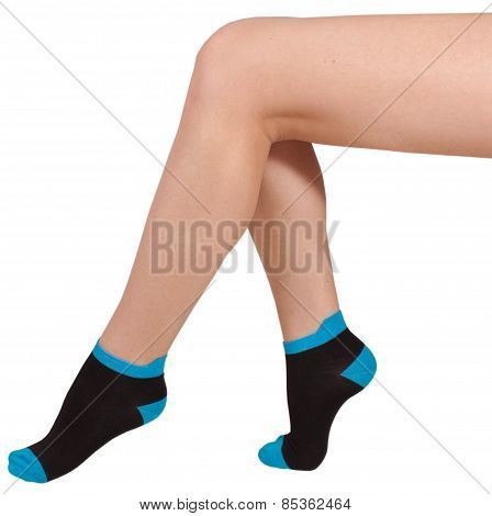 Female legs in socks. Isolated on white background