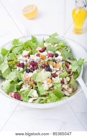 Salad With Gorgonzola Cheese And Dry Berries In White Bowl