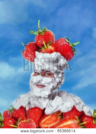 Smiling man with whipped cream and strawberries