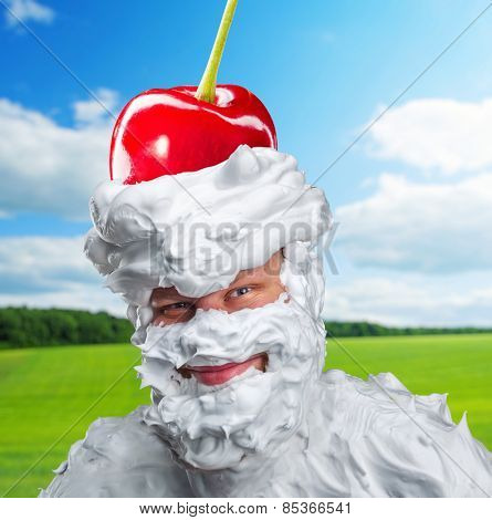 Smiling man with whipped cream and a cherry