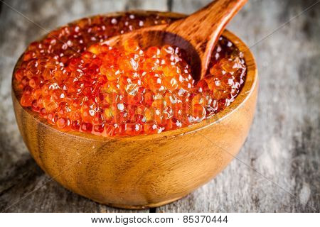 Fresh Red Caviar In A Wooden Bowl With A Spoonful Closeup