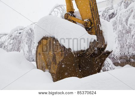 Excavator Shovel Covered With Snow